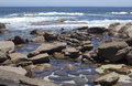 Rocky beach augusta west australia in summer the at the old water wheel at western where the deep blue southern ocean laps the Royalty Free Stock Image