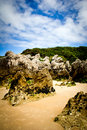 Rocky beach landscape in llanes asturias Royalty Free Stock Photo