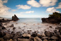 Rocky beach with moving water Royalty Free Stock Photography