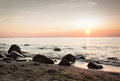 Rocky beach sunset beautiful at baltic and sea Royalty Free Stock Photos
