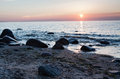 Rocky beach sunset beautiful at baltic and sea Stock Images