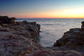 Rocky beach at sunset beautiful over the sea on the Royalty Free Stock Image