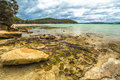 Rocky beach in tasman peninsula rocks lime bay camping inside the lime bay state reserve located at the northern end of the to the Royalty Free Stock Photos