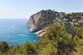 Rocky beach typical costa brava landscape near tossa de mar girona spain boats in sea Royalty Free Stock Photos
