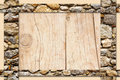Rocky border background abstract frame with stone borders over wooden board Stock Images