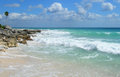 Rocky caribbean beach in mexico riviera maya cancun with white sand and waves crashing lava rocks Stock Images
