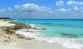Rocky caribbean beach in mexico riviera maya cancun with white sand and waves crashing lava rocks Stock Image