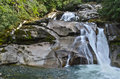 Rocky clayton falls bella coola bc canada crystal clear water running over rocks in the forest Royalty Free Stock Images