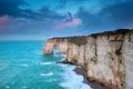 Rocky cliff in azure ocean waves etretat normandie france Royalty Free Stock Photos