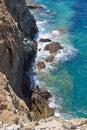 Rocky cliff and sea waves on crete island greece Stock Photo