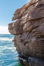 Rocky cliffs over blue sea Stockfotos