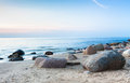 Rocky coast beach beautiful sunset at baltic and blue sea over sky horizont Royalty Free Stock Images