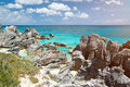 Rocky coast with blue water Royalty Free Stock Photo