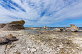 Rocky coast with limestone cliffs in sweden coastline raukar fårö island gotland Royalty Free Stock Photo