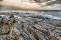 Rocky coast of maine barnacle covered rocks along the at sunrise Stock Photo