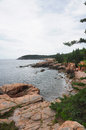 The rocky coast of maine looking towards otter cliffs at on mount desert island in acadia national park Stock Photos
