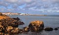 Rocky coast rugged beauty of atlantic ocean a view of the harbor of douarnenez brittany france Stock Image