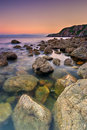 Rocky coastline in ireland sunset over shore howth peninsula republic of europe Stock Photo