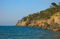Rocky coastline of majorca scenic view with calm blue sea in background balearics spain Royalty Free Stock Image