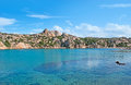 The rocky harbor small scenic of cala spalmatore with bright blue waters shores and cozy sand beach maddalena island sardinia Royalty Free Stock Photography