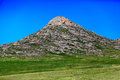 Rocky hill over clear blue sky background Stock Photos