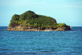 Rocky island covered by tropical vegetation bocas del toro archipelago bastimentos caribbean sea panama Stock Image