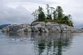 Rocky islet in the north pacific along coast of british columbia Royalty Free Stock Photos