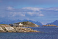 Rocky islets in norway small on norwegian coast of lofoten islands with small fishing harbor Stock Images