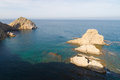 Rocky javea coast beautiful emerald waters on javeas coastline Stock Image