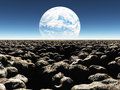 Rocky landscape with planet or terraformed moon in th earth the distance Royalty Free Stock Images