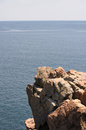 Rocky ledge a overhanging the blue ocean of the atlantic in maine Royalty Free Stock Photo