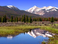Rocky Mountain Landscape with River and Snow Peaks Royalty Free Stock Photos
