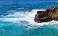 Rocky Outcrop in Hawaiian Blue Waters Royalty Free Stock Photo
