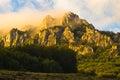 Rocky peaks at foggy sunrise, trekking path at Suva Planina mountain Royalty Free Stock Photo