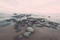Rocky sea beach with wide angle perspective vintage vintage over the clouds effect photography effect Royalty Free Stock Photos