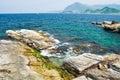 Rocky seashore and wavy ocean Stock Photo