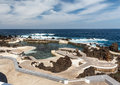 Rocky shore and natural pool. Royalty Free Stock Photo