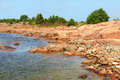 Rocky shore red granite of aland islands finland Stock Photos