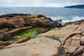 Rocky shore rugged at ocean s edge in maine Stock Photo