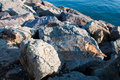 Rocky shore on a seaside avenue near the city Royalty Free Stock Photography
