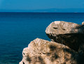 Rocky shoreline aegean sea in a summer day Royalty Free Stock Images