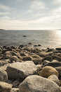 Rocky Shoreline over Ocean Royalty Free Stock Photo
