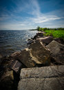 The rocky shores of the st lawrence seaway large boulders line river in ontario canada Stock Photo