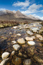 Rocky stream from beinn eighe mountain flows the range Stock Photos
