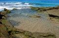 Rocky tide pool scene in Laguna Beach, California. Royalty Free Stock Photo