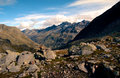 Rocky trail leading to valley surrounded by high mountains in swiss alps switzerland Stock Photo