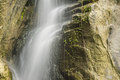 Rocky waterfall on the mountain with moss Royalty Free Stock Photos