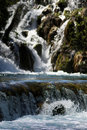 Rocky waterfall on river Stock Images