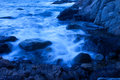 Rocky and the waves blue shot long exposure Royalty Free Stock Images