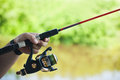 Rod and spinning reel freshwater fishing hand holding casting bait Stock Images